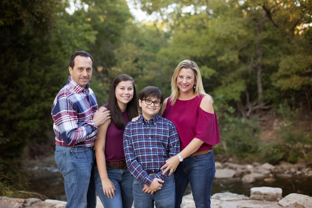 Family of four photographed at Prairie Creek Park in Richardson Texas overlooking the creek