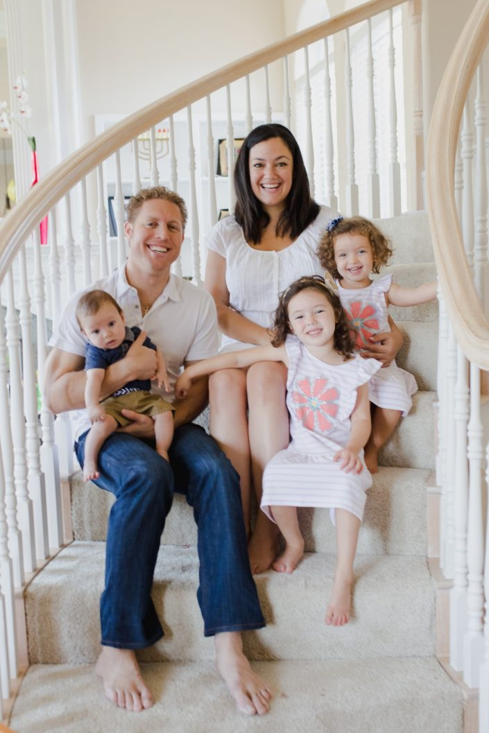 Family of five sitting on staircase during family photo session