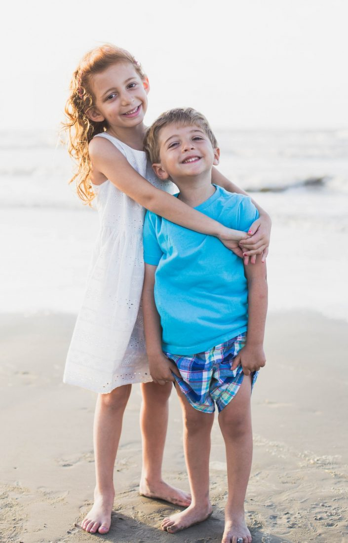 Family of four at beach in Galveston Texas