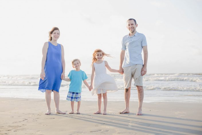 Family of four at beach in Galveston Texas