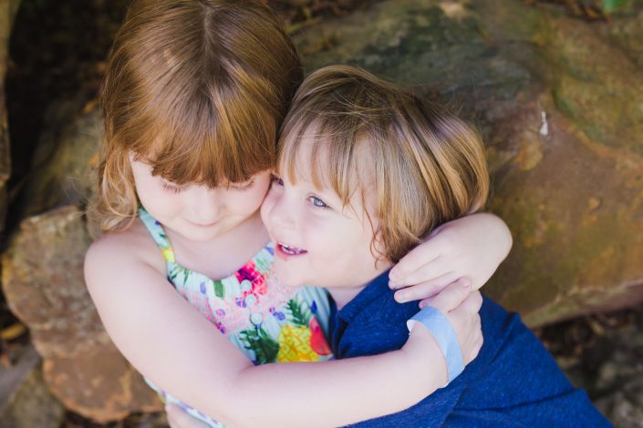 Brother and sister hugging near Whiterock Lake Dallas Texas