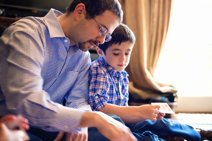Father and son playing board game together