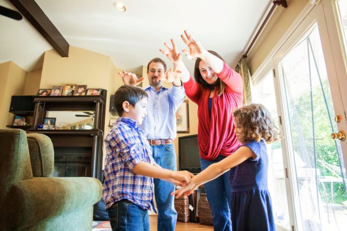 Family dancing together during lifestyle photo session