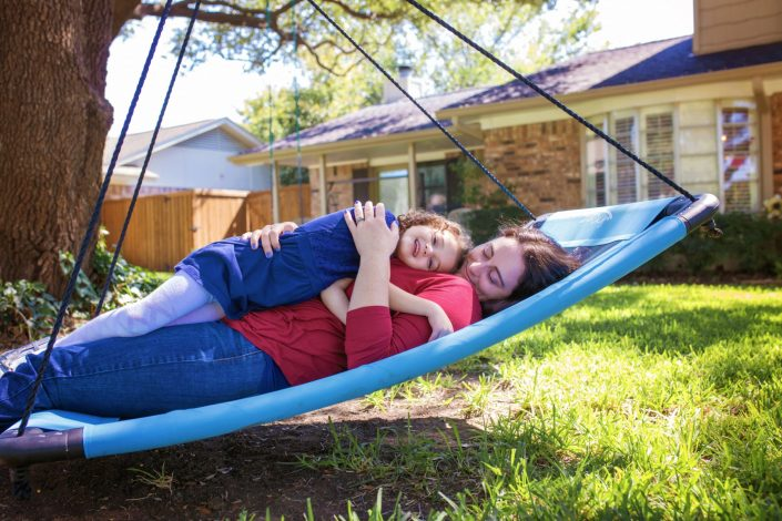 Mother and daughter on swing together