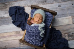 dallas newborn photographer poses baby with sweet little owl