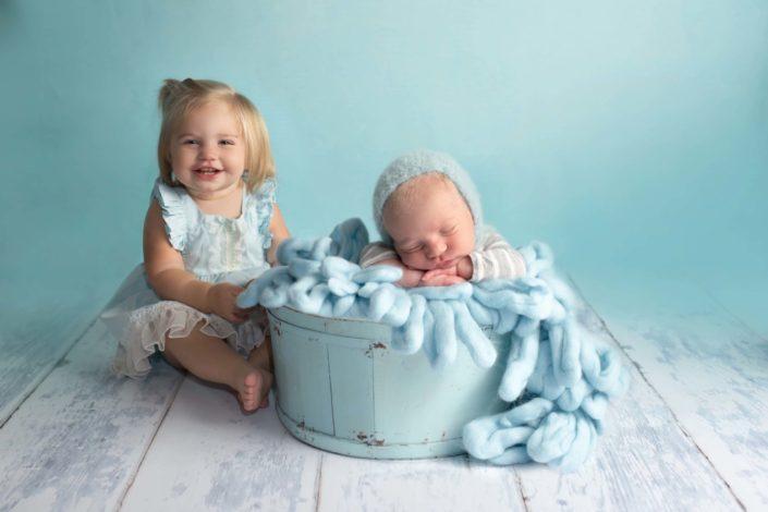Dallas newborn boy and big sister photographed in studio Far North Dallas