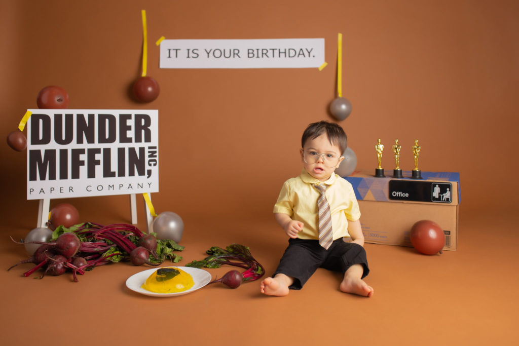 First birthday cake smash with The Office theme featuring baby Dwight Schrute