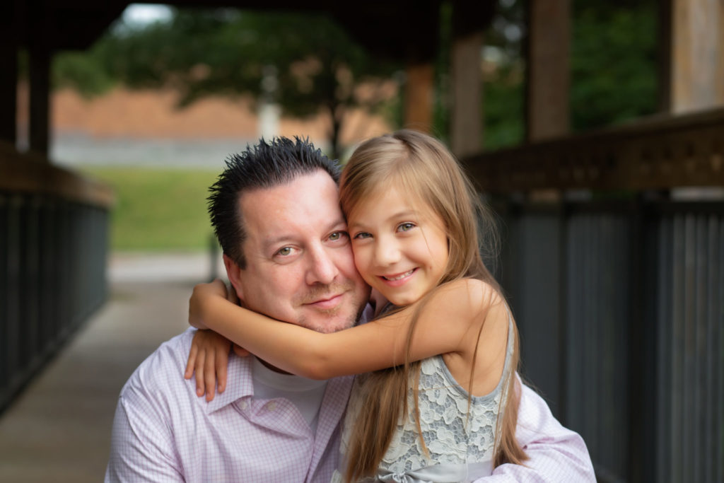 Dallas family photographer takes father daughter portrait at Richardson Texas park. Prairie Creek Park.