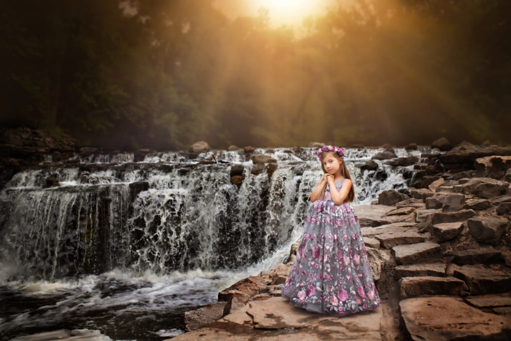 Child photography session by waterfall at Prairie Creek Park in Richardson near Dallas Texas