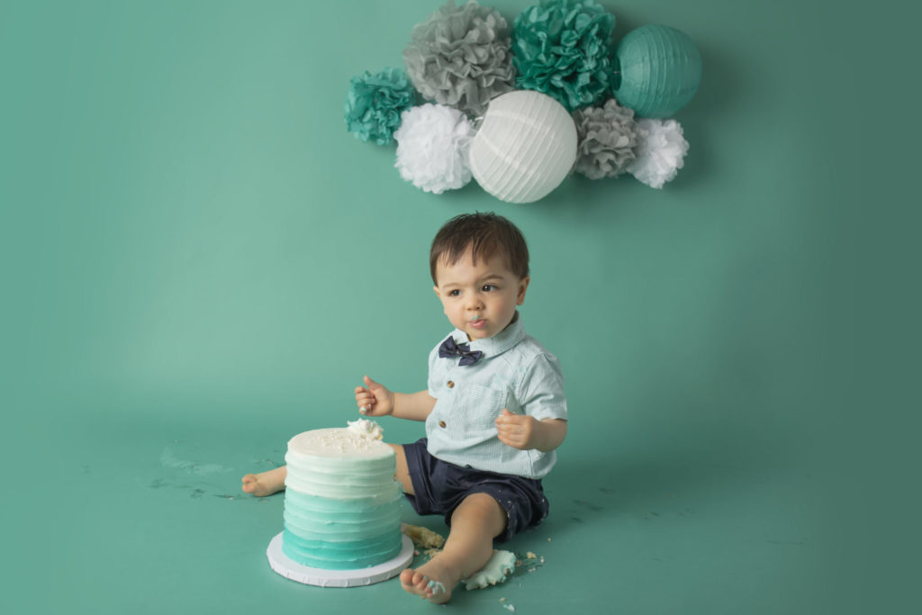 cake smash photographer in dallas creates beautiful teal ombre cake smash theme