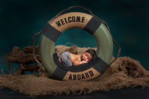 Dallas newborn photographer captures baby nursery theme with picture of baby in a life preserver