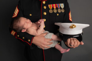 Dallas newborn photographer honors veteran dad in this photo of baby held by marine father